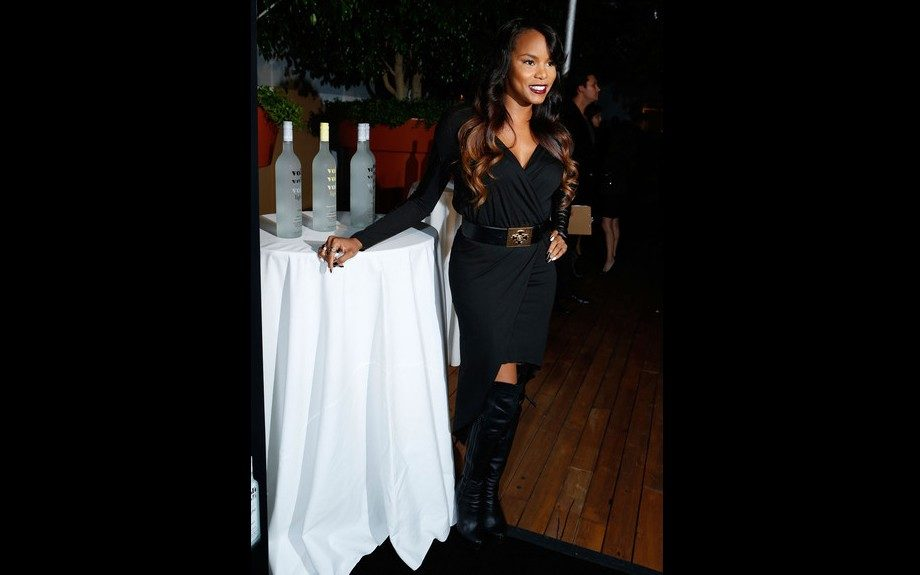 Letoya Luckett attended the Voli Light Vodka's Holiday Party in West Hollywood in over-the-knee leather boots and a Mason by Michelle Mason Hi Lo Leather Sleeve Dress. Photo Credit: Splash