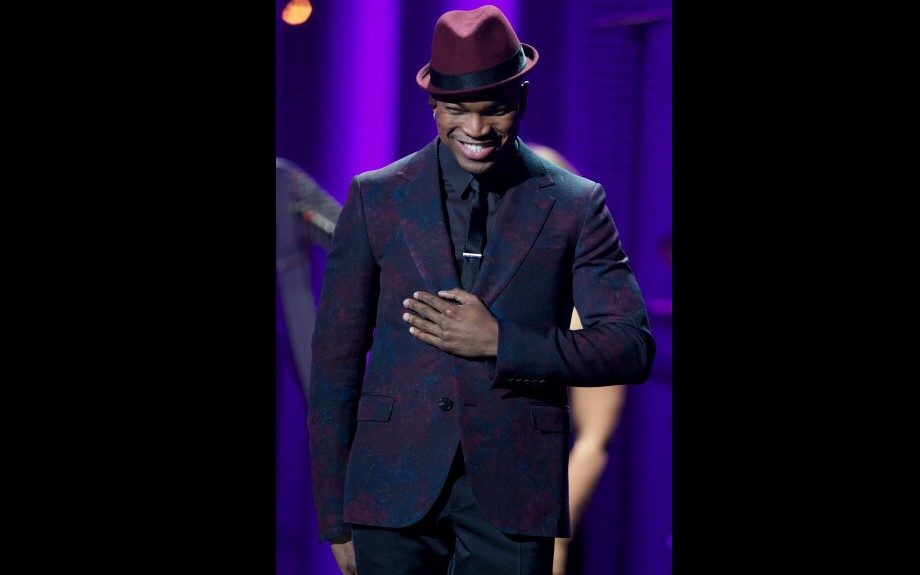 Ne-Yo performed at the Nobel Peace Prize Concert in Oslo wearing an oxblood fedora with a printed Dandy Jacket from Gucci's Fall 2012 collection. Photo Credit: Getty