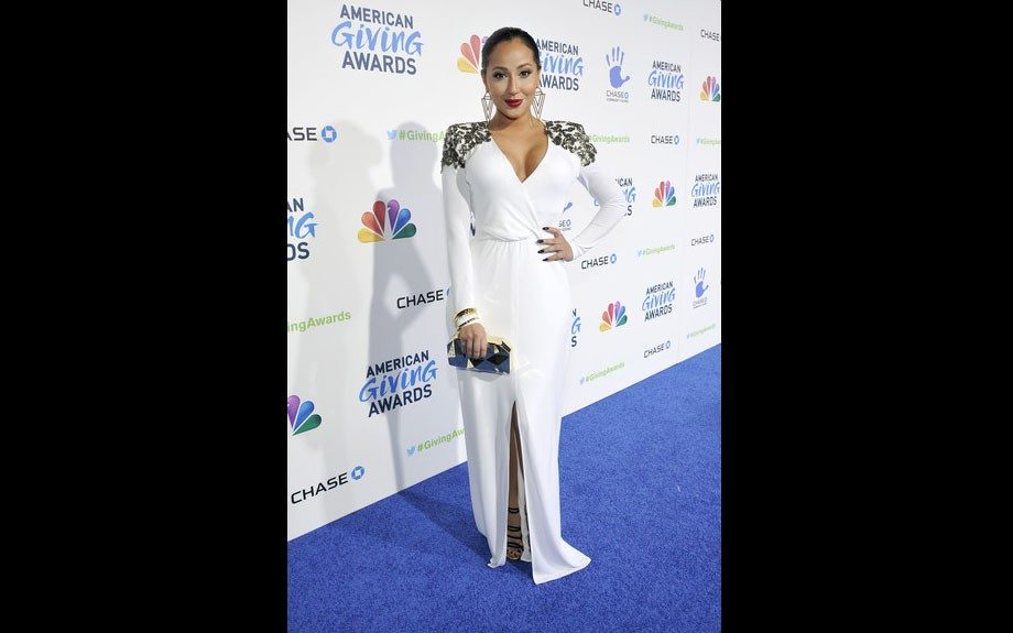 Adrienne Bailon at the American Giving Awards in Pasadena, California wearing a BCBGMAXAZRIA Anna Sequin Shoulder Evening Gown, a mirror leather clutch, and Jimmy Choo Bunting Sandals. Photo Credit: WENN