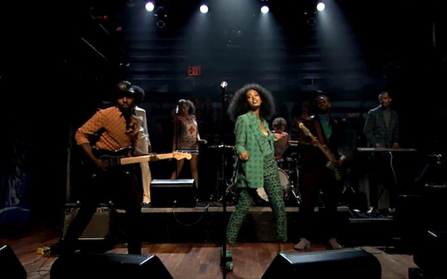 Solange Knowles performs on Late Night with Jimmy Fallon in a pair of $537 Miu Miu Embellished Snake Effect Leather Boots and a polka dot blazer, matching shirt. Photo Credit: INF