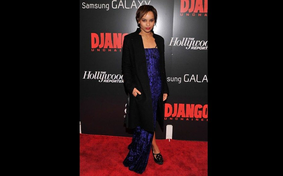 Zoe Kravitz made an appearance at the NYC Screening of Django Unchained in a blue strapless gown accented by a black coat and shoes, her image is always slightly eclectic and this was no different. Photo Credit: WENN