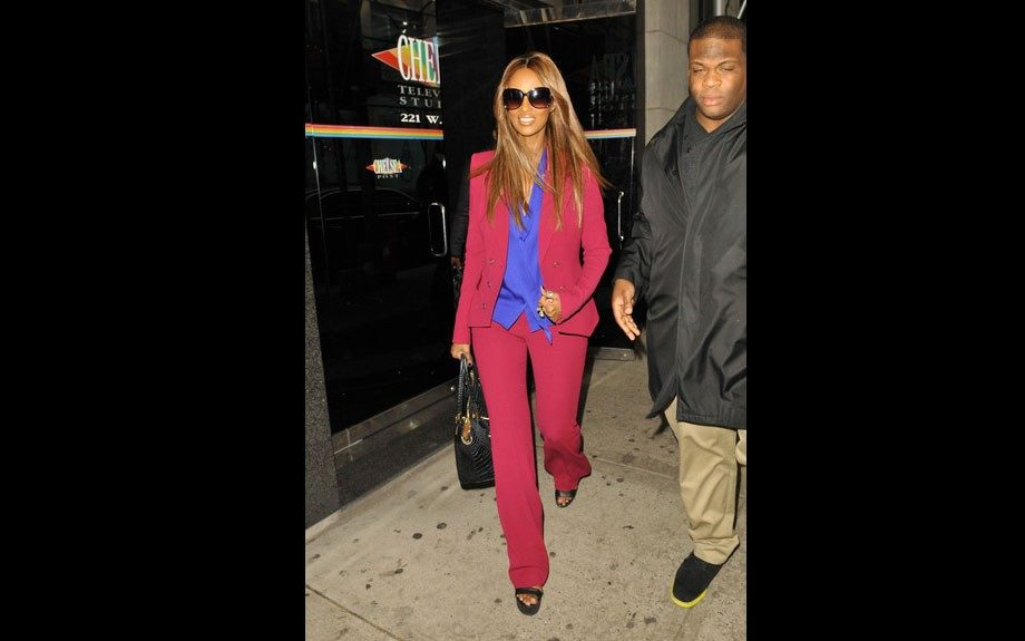 Iman hit up the Wendy Williams in a Rachel Zoe cranberry suit, and a blue button down shirt by the brand. Photo Credit: Splash