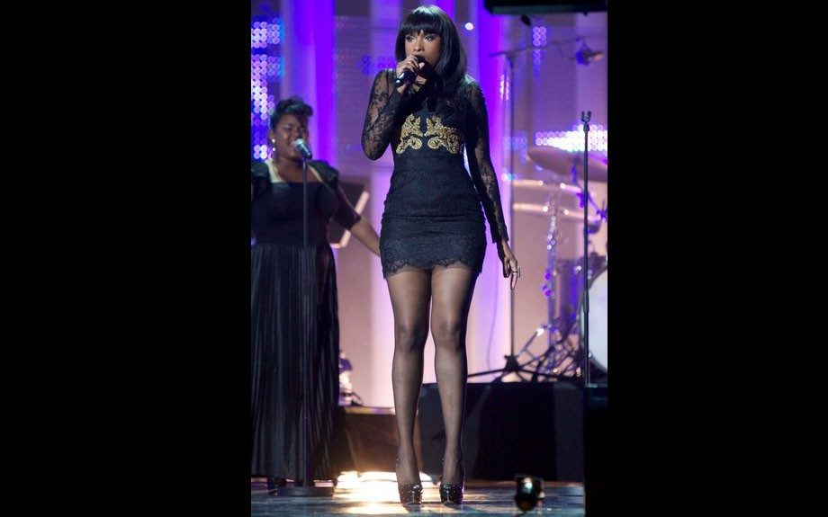 Jennifer Hudson performed at the Nobel Peace Prize Concert held in Norway sporting a Dolce & Gabbana Fall 2012 lace dress with gold embroidery, and a pair of black platform pumps. Photo Credit: WireImage