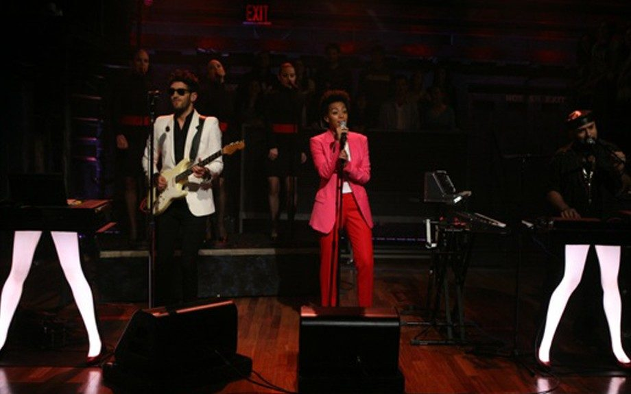The natural beauty took her mini 'fro to the stage in a hot pink blazer and red, straight leg pants