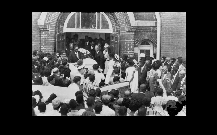 The body of 14-year-old Carol Robertson, one of four girls killed in the bombing of 16th Street Baptist Church, Birmingham, Alabama. September 1963