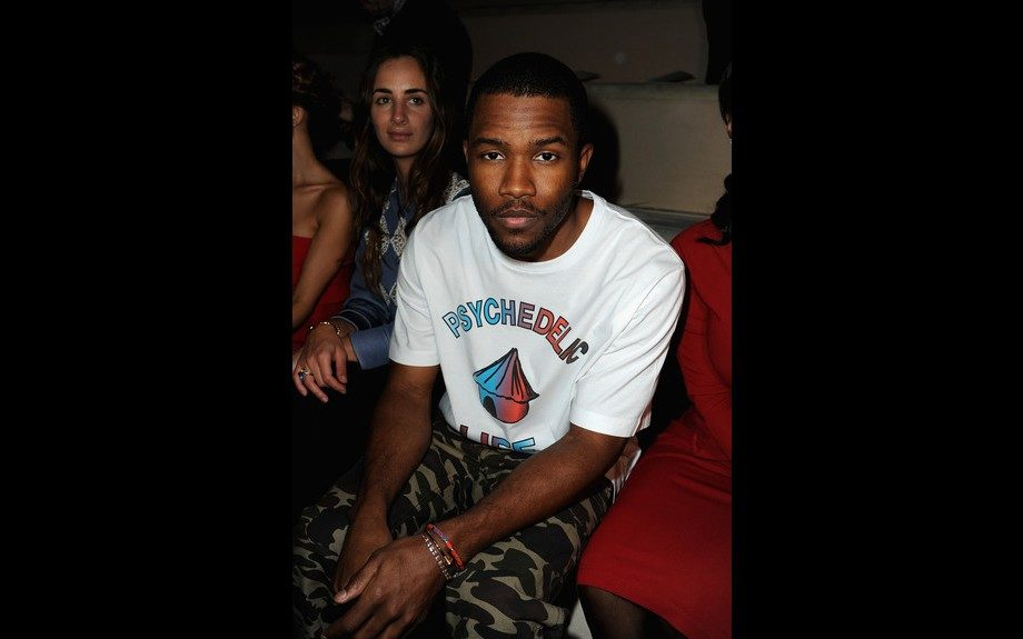 Frank Ocean checked out a fashion show in a Perks and Mini PAM Psychedelic Life Tee, and camo print pants. Photo Credit: WireImage