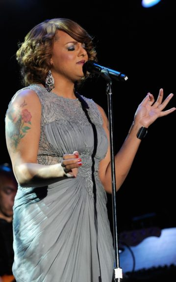 Singer Marsha Ambrosius onstage at Clive Davis and the Recording Academy's 2012 Pre-GRAMMY Gala and Salute to Industry Icons Honoring Richard Branson held at The Beverly Hilton Hotel. (Photo by Larry Busacca/Getty Images For The Recording Academy)
