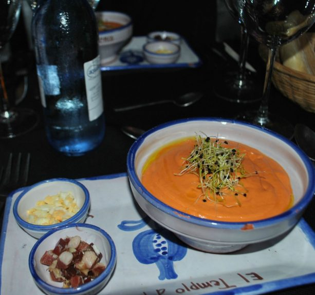 Gazpacho: a Spanish culinary staple influenced by the Moors, served with Iberian ham and cheese accompaniments
