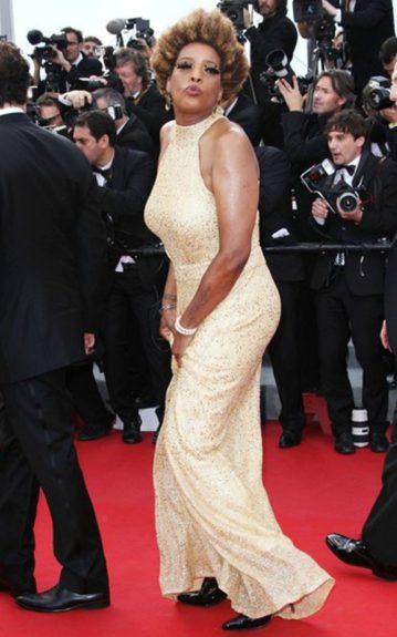 Macy Gray sported her natural 'fro with dramatic, false feathered lashes and a high halter gold gown on the red carpet of The Paperboy premiere