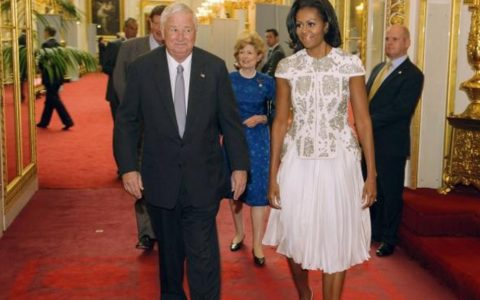 THIS DAY IN FASHION: Michelle Obama Kicks off Olympics at Buckingham Palace
