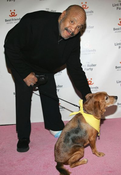 The late James Avery pals around with a pooch.