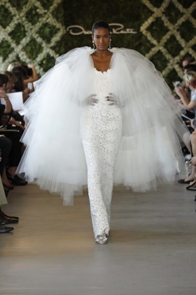 "<div> 	<span style=""font-size:14px;""><font face=""Calibri,sans-serif"">A master of Couture Bridal, model Arlenis Sosa in his Spring 2011 Collection.</font></span></div> <div> 	 </div>"
