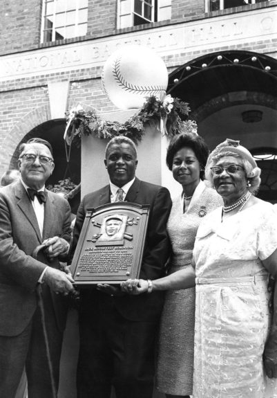 Jackie Robinson is pictured with Branch Ricky, his mother Millie Robinson and wife Rachel as the celebrate Jackie Robinson's induction into the Baseball Hall of Fame. (Moneta Sleet, Jr./ EBONY Collection) Shop the entire EBONY Collection