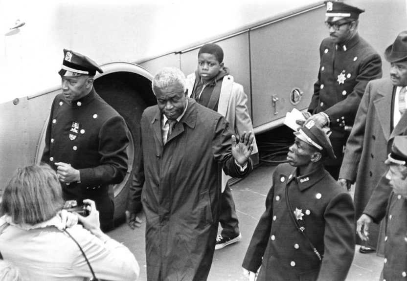 "Baseball great Jackie Robinson is ushered through barriers as he arrives for Adam Clayton Powell Jr. funeral at Abyssinian Baptist Church.(G. Marshall Wilson/ EBONY Collection) Shop the entire EBONY Collection <strong><a href=""http://www.ebony.com/store#axzz2PsEj7sec"" target=""_blank"">here</a></"