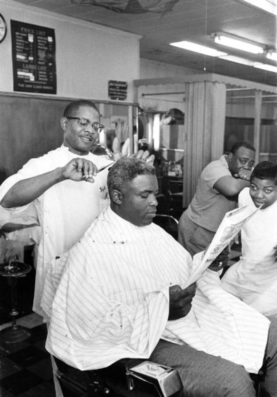 "Featured in EBONY August 1958, issue David Jett joyfully cuts baseball great Jackie Robinson's hair. (G. Marshall Wilson/ EBONY Collection) Shop the entire EBONY Collection <strong><a href=""http://www.ebony.com/store#axzz2PsEj7sec"" target=""_blank"">here</a></strong>."