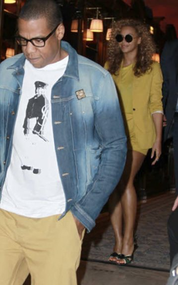 Jay-Z goes preppy in a denim jacket, printed tee, and camel khakis. His glasses were the icing on top of the nerd-chic cake