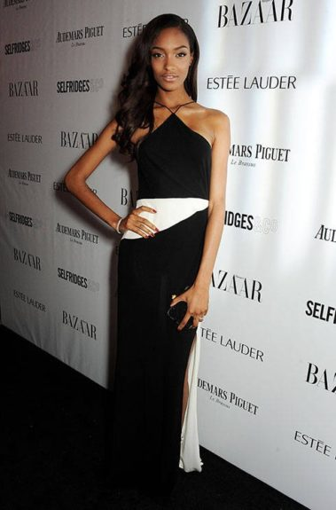 Model of the Year at the 2013 <em>Harper's Bazaar</em> Awards, Jourdan lets her natural beauty shine through with simplistic make-up, loose side-swept curls, and a black and white halter gown by Tom Ford.
