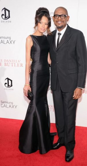 Keisha Whitaker gave face in her graceful black Badgley Mischka gown. She's quite the arm candy for her hubby Forest, who matched her in a black tailored suit, and white and black skinny tie. <em>Photo</em>: Getty