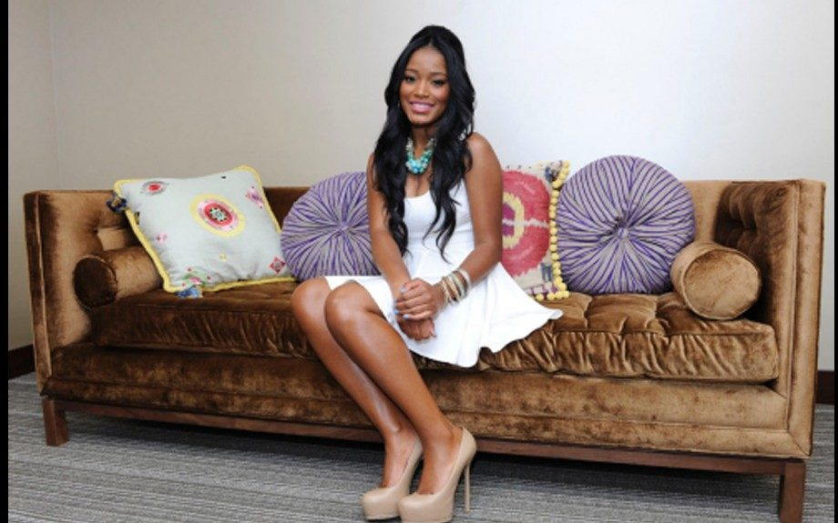 Keke looks very girly in her cream summer dress, nude pumps, and teal necklace