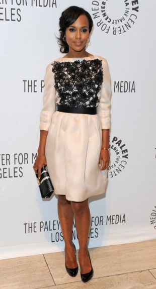 Conservative and graceful, Kerry hits up an ABC Fall Preview party last year in this cream Christian Dior number with black rosette detail, barely there makeup, and a loose chignon.