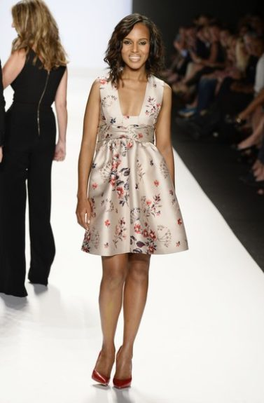 This look is all Kerry in a floral low cut Stella McCartney Spring 2014 dress and red pumps, as she walked the runway during a <em>Project Runway</em> finale. Her nude lip was good, but a pop of color could have really set things off.