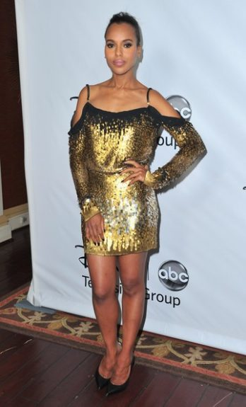 Playing up her glamorous side, Kerry walks the red carpet in a gold sequined Jenny Packham mini-dress, pulling back her hair to give more face action.