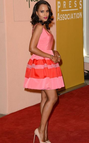Kerry Washington is flirty and girly in her red and pink Christian Dior dress, and nude pumps. Photo Credit: Getty