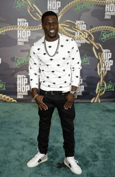 On the red carpet at the eighth annual <em>BET Hip-Hop Awards</em>, Kev kept it stylish in this eye-catching Kenzo sweatshirt, black jeans, and white and black sneakers.