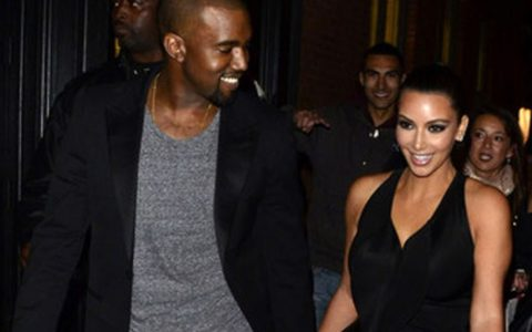 THIS DAY IN FASHION: Kanye West and Kim All Dressed Up
