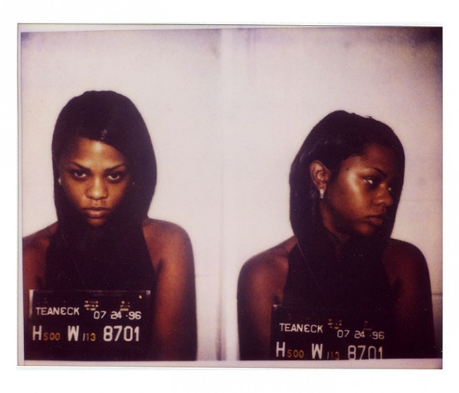 1996 mug shot of Lil' Kim.
