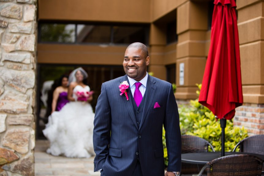 The groom Christopher E. Chidi wears a Hugo Boss suit at Philadelphia's Philmont Country Club