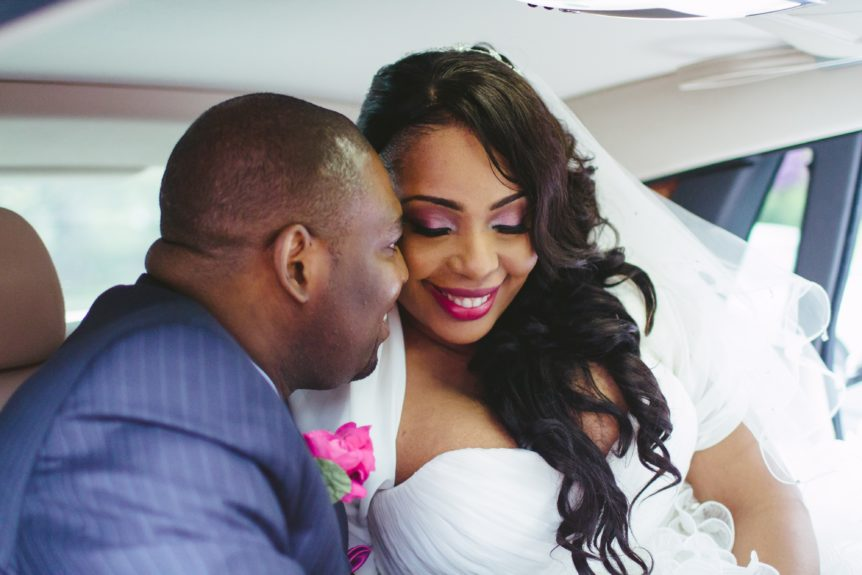 The couple enjoy a wedded moment in an all-white Rolls Royce