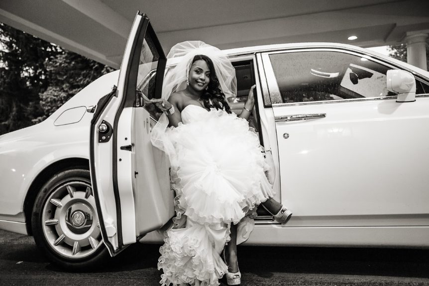 Classic! The bride Lyndah Ofili steps out of an all-white Rolls Royce