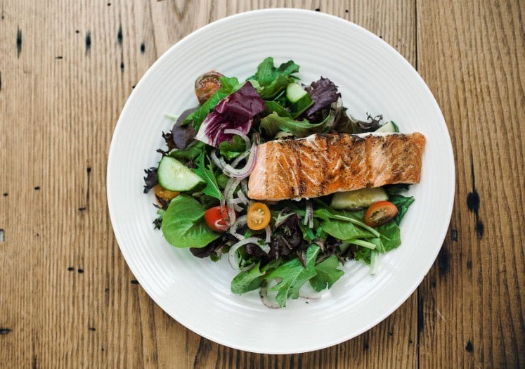 "<p> 	The ""Grown Simple Greens"" with grilled salmon (Photo: April Belle Photos)</p>"
