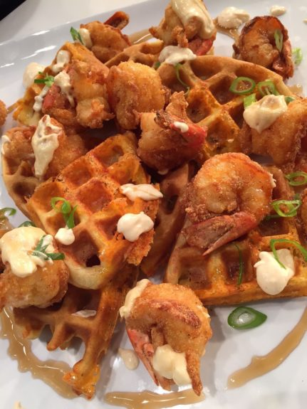 <p> 	Smoked Cheddar and Herb Waffles with Corn Meal Fried Shrimp Creole Aioli and Maple Syrup (Photo: Richard Ingraham)</p>