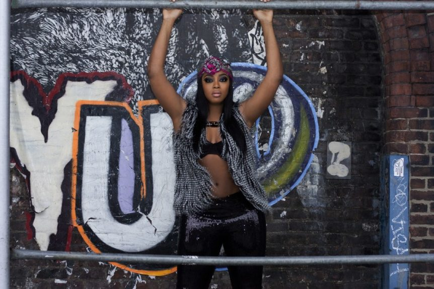 Liris is giving us urban grunge and sex appeal. <em>Scarf by Adrienne Vittadini, Bra by Victoria's Secret, Necklace-Melody Ehsani ,Vest- Forever 21,Sequin Leggings from EverythingCurvy&Chic Boutique<b>. </b></em><strong><em>Photos by Myah Jones and H&M artist Joanna <