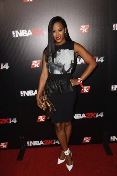 Malaysia Pargo shows us how to mix street chic with class in this Tupac screen graphic tee, black peplum skirt from Zara, and sexy pointed toe pumps by Versace.