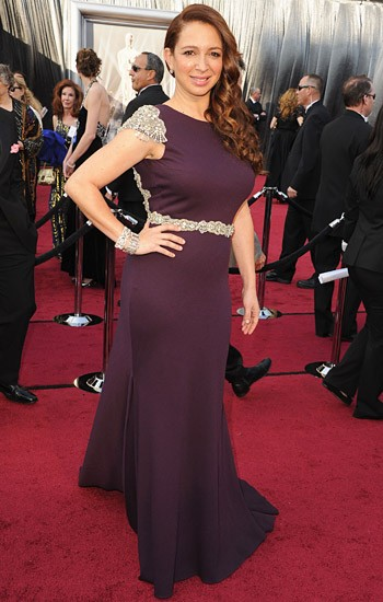 Funny woman Maya Rudolph in a plum Johanna Johnson evening dress with embellished waist and sleeves