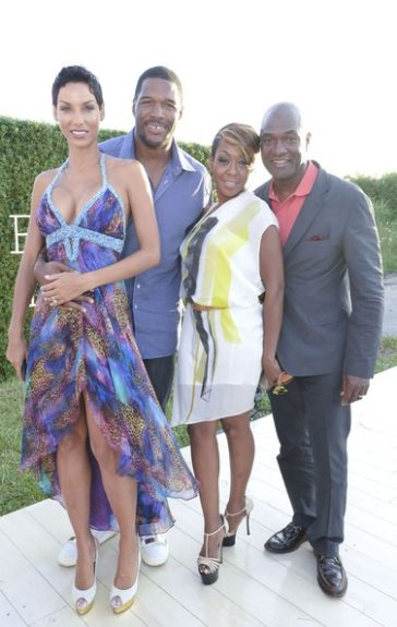 Nicole Murphy and her beau Michael Strahan posed it up with Tichina Arnold and her guest. <em>Photo</em>: Getty