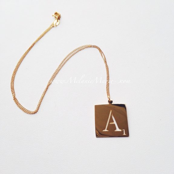 "<a href=""http://melaniemarie.com/shop/gold-collection/scrabble-letter/"" target=""_blank"">Scrabble Letter Necklace </a>"