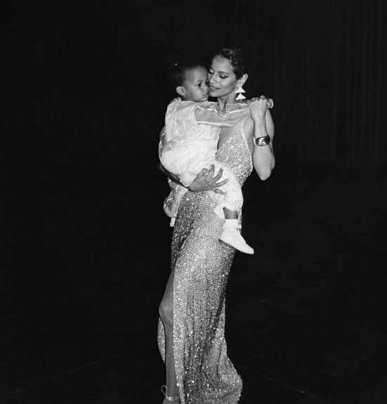 Debbie Allen celebrates the success of her opening night performance in Sweet Charity at Broadway's Minskoff Theatre in New York City. Debbie dances with her daughter, Vivian Nichole, during a reception in the Marriott Hotel. (Bob Johnson/EBONY Collection).  	View the entire EBONY Co