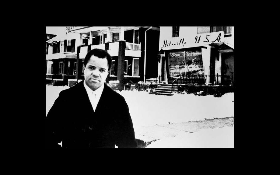 "Berry Gordy poses outside ""Hitsville USA"", the original headquarters of his company in Detroit, 1960."