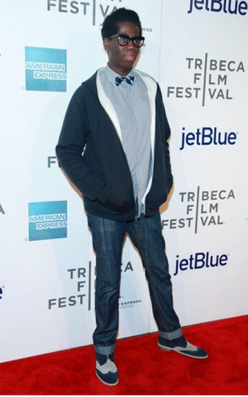 Miss Jay went for a geek-chic look sporting his blue suede shoes with a pair of jeans and a collared shirt topped off with a bowtie and statement glasses.