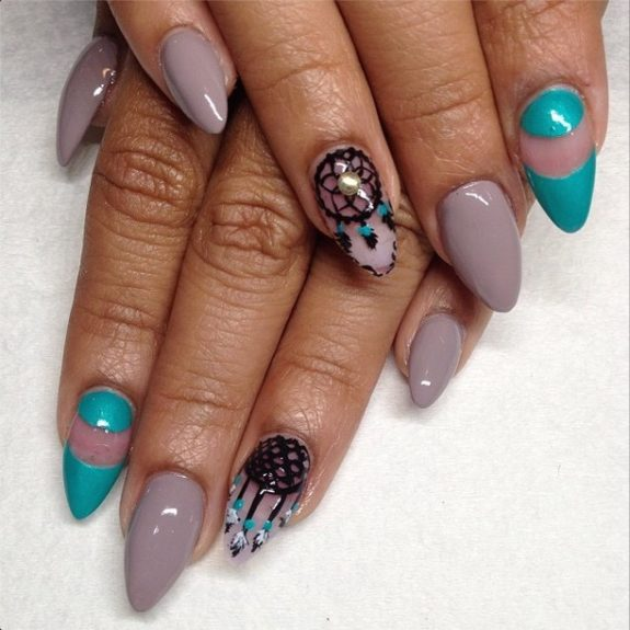 Done in neutrals with a pop of color, this dream catcher accent nail design stands out, in a good way.