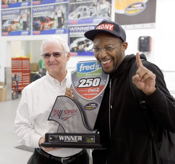 "If you're not first you're last! Red Horse Racing owner <span class=""s1"">Tom</span> DeLoach and I holding up the trophy from Red Horse's victory at Talledega Superspeedway"
