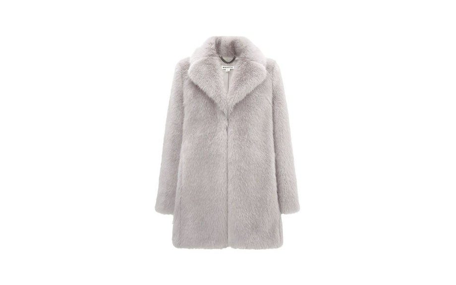 "Whistles Kumiko Faux Fur Coat, $450, <a href=""http://www.whistles.com/women/clothing/coats-jackets/kumiko-faux-fur-coat.html?dwvar_kumiko-faux-fur-coat_color=Navy#start=1"" target=""_blank"">www.whistles.com</a>."