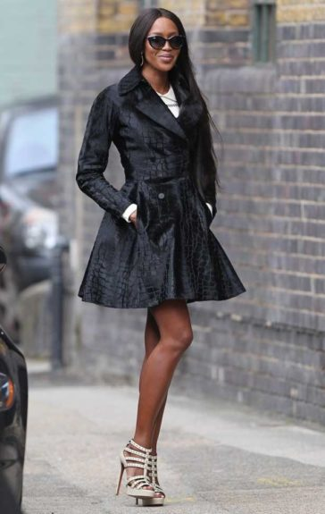 Naomi Campbell knows she's a picture of perfection as she trots about in London doing some press for <em>The Face UK</em>, in an Azzedine Alaïa calf hair croc print coat from the brand a pair of patent leather Cage sandals. Photo Credit: Splash