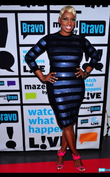 Nene loves black, and popped in some sequins with this Marc Jacobs Sequined Striped Sweater, and matching skirt ensemble. Photo Credit: INF