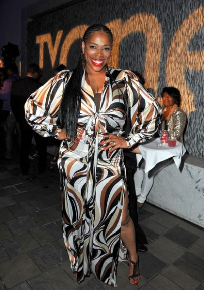 Nicci Gilbert gave us a little thigh action in her printed maxi with puffed sleeves.<em> photo: WENN</em>