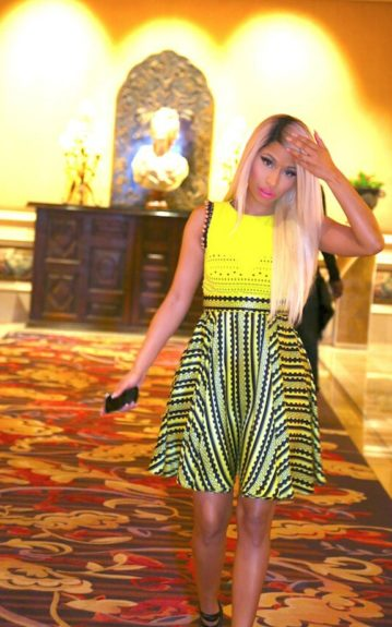 Look of the Week: Nicki Minaj is dressed in a gorgeous Versace dress that compliments her skin tone, and we're glad to see she's coming into her own personal style. Photo Credit: Nicki's Twitter